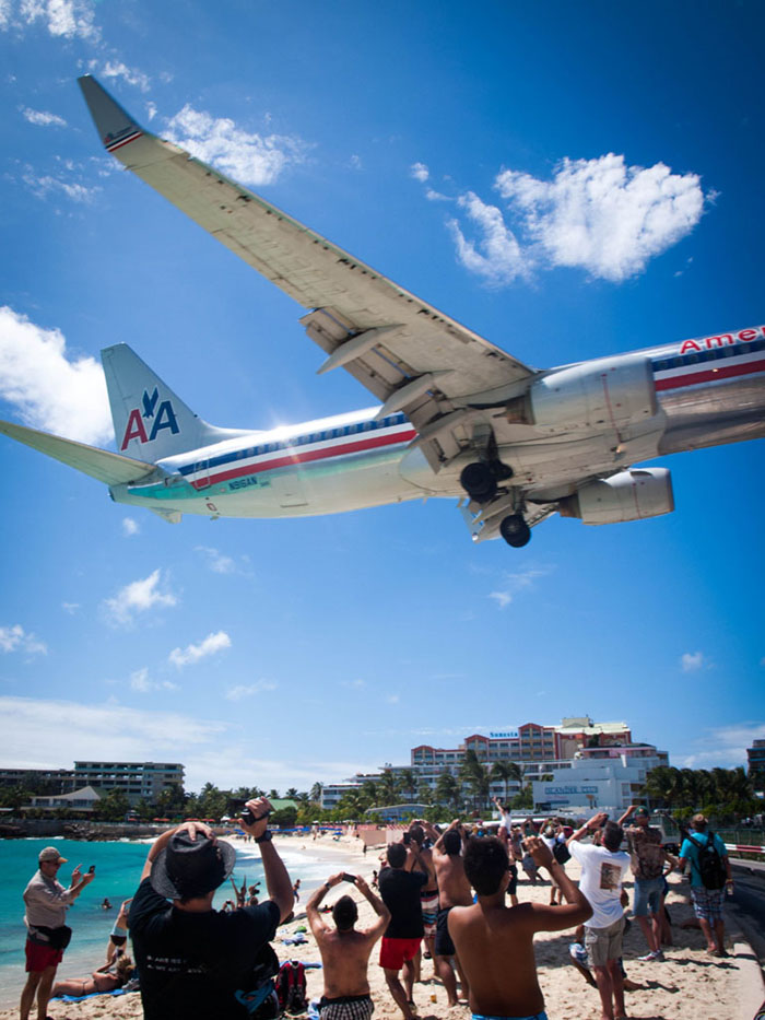 america airlines jet above maho beach